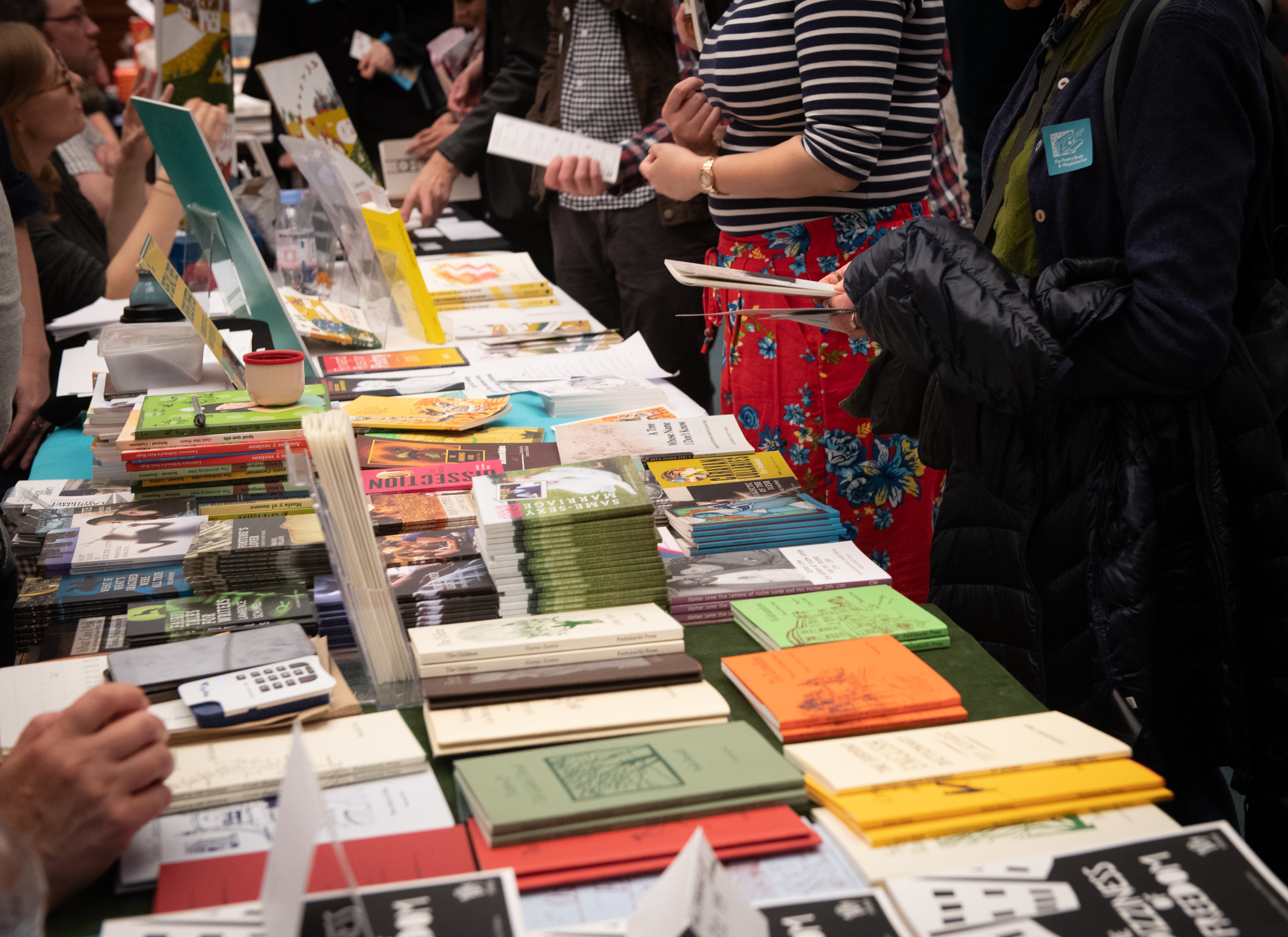 Photo of a table of books laid out at the Free Verse Book Fair 2018