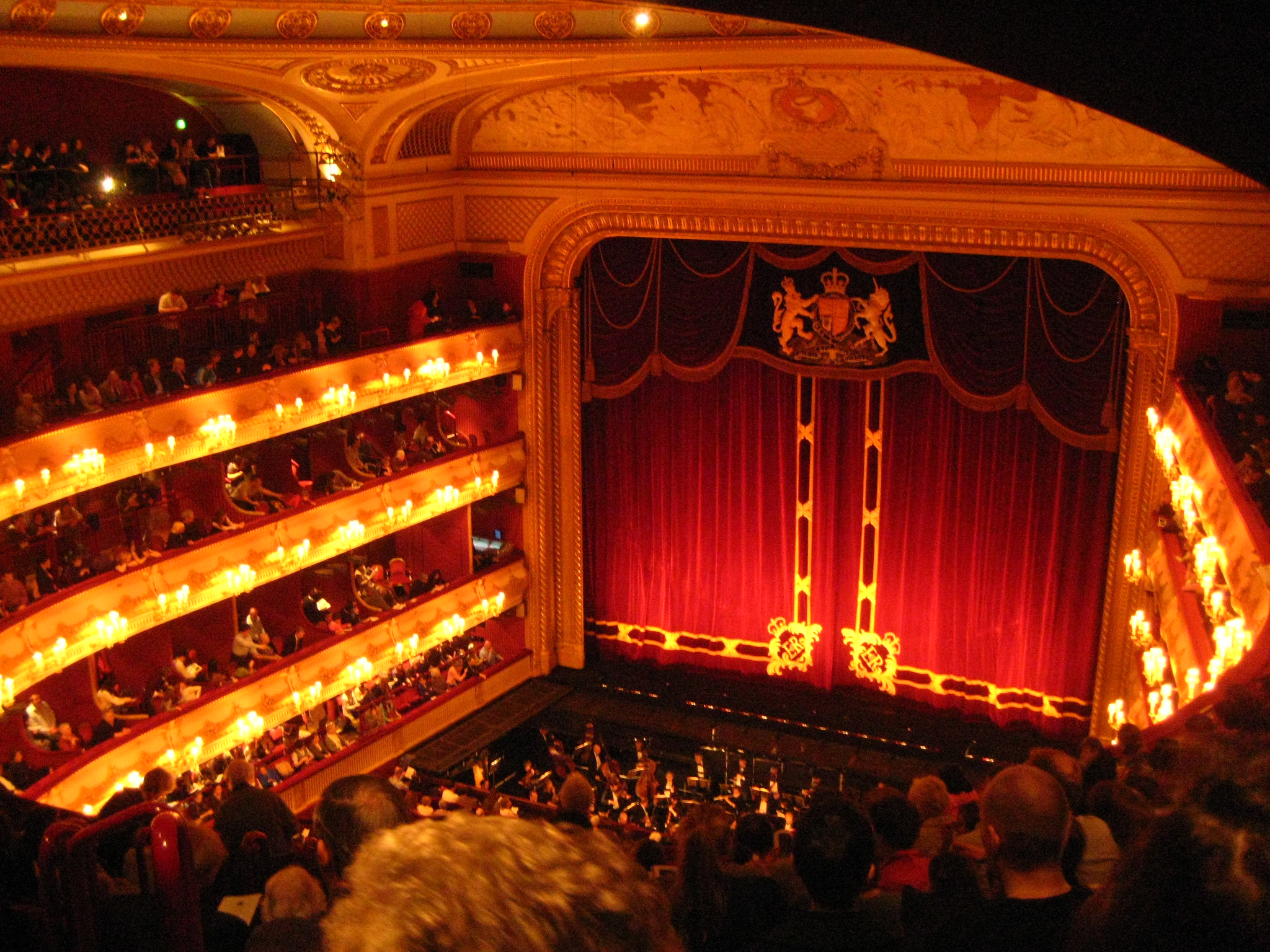Inside the Royal Opera House, with red curtains across the stage
