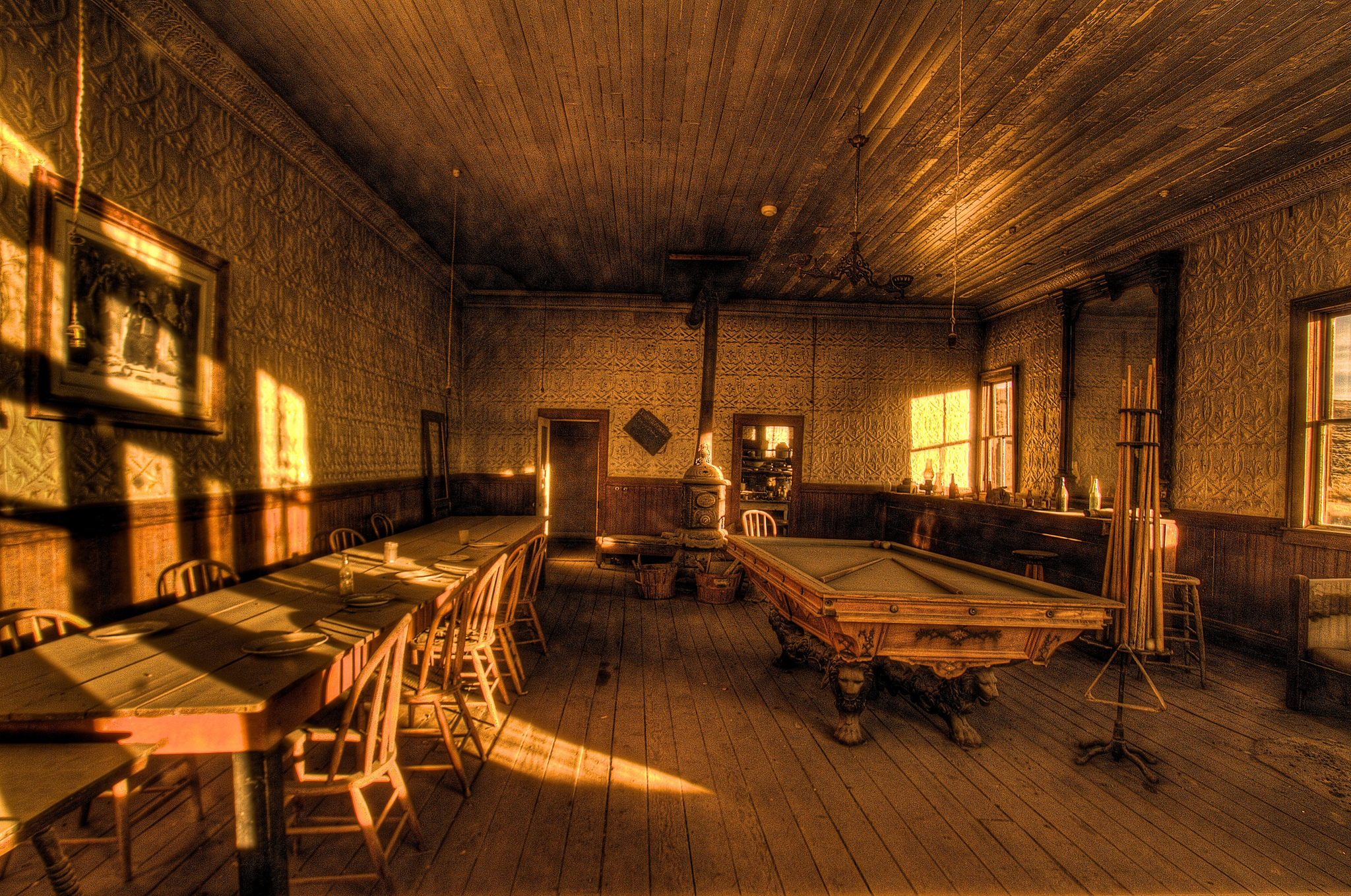 old fashioned pool hall lit up by the sun and made to look golden in the sunset