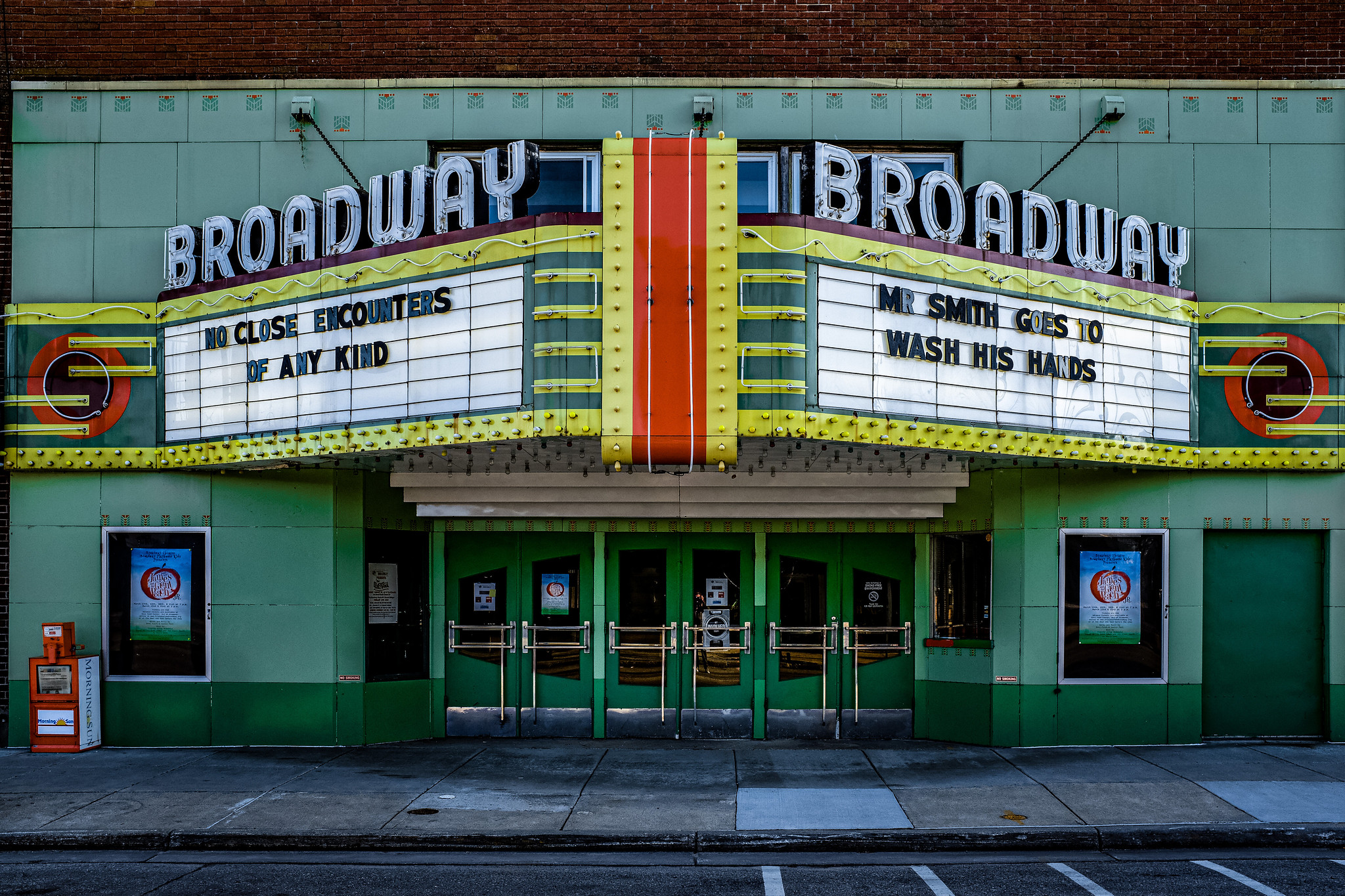 Photo of the front of a theatre.   Closed during the COVID-19 pandemic, Mt. Pleasant's Broadway Theatre uses its marquee to spread a (comedic) message in support of social distancing and hand washing
