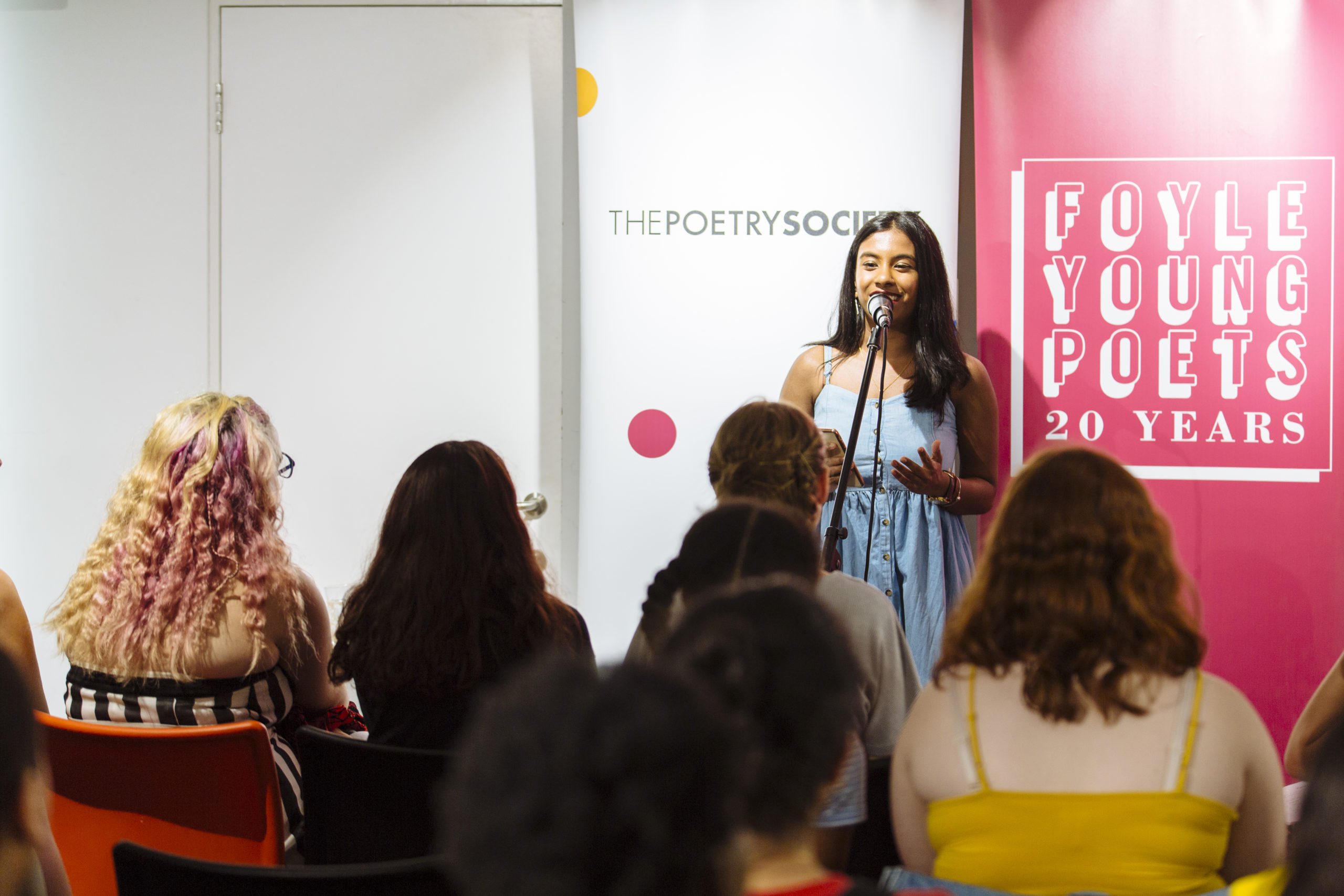 Young poet performing at a Young Poets Takeover event