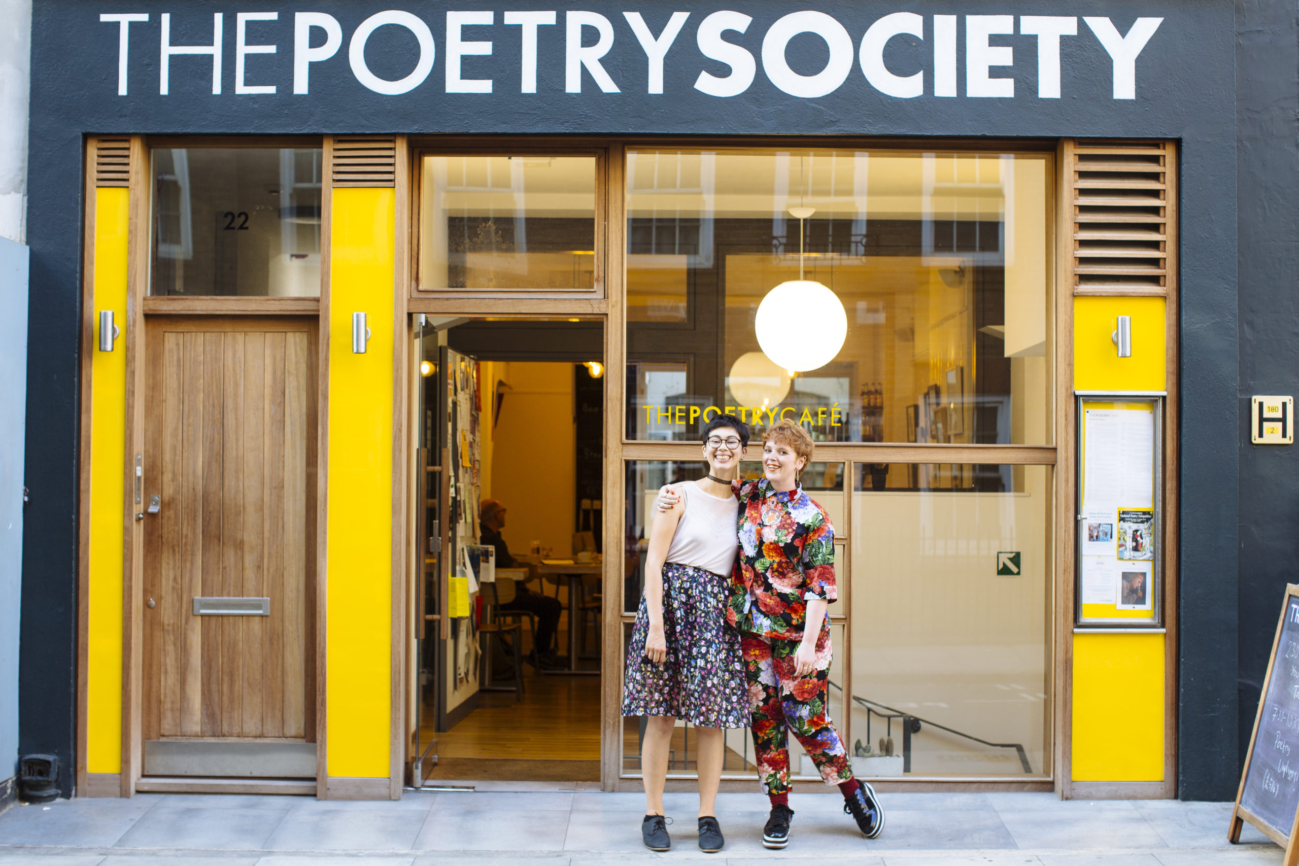 Photo of Helen and Alice outside The Poetry Café