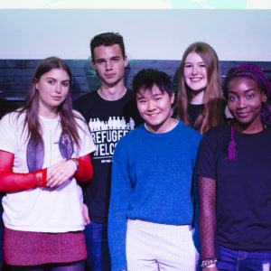 Image of SLAMbassadors 2017 winners: from left to right, Mukahang Limbu, Emmeline Armitage, Eben Roddis, Honey Birch, Chelsea Stockham, Arinola Adegbite, and Charlotte Sonnex