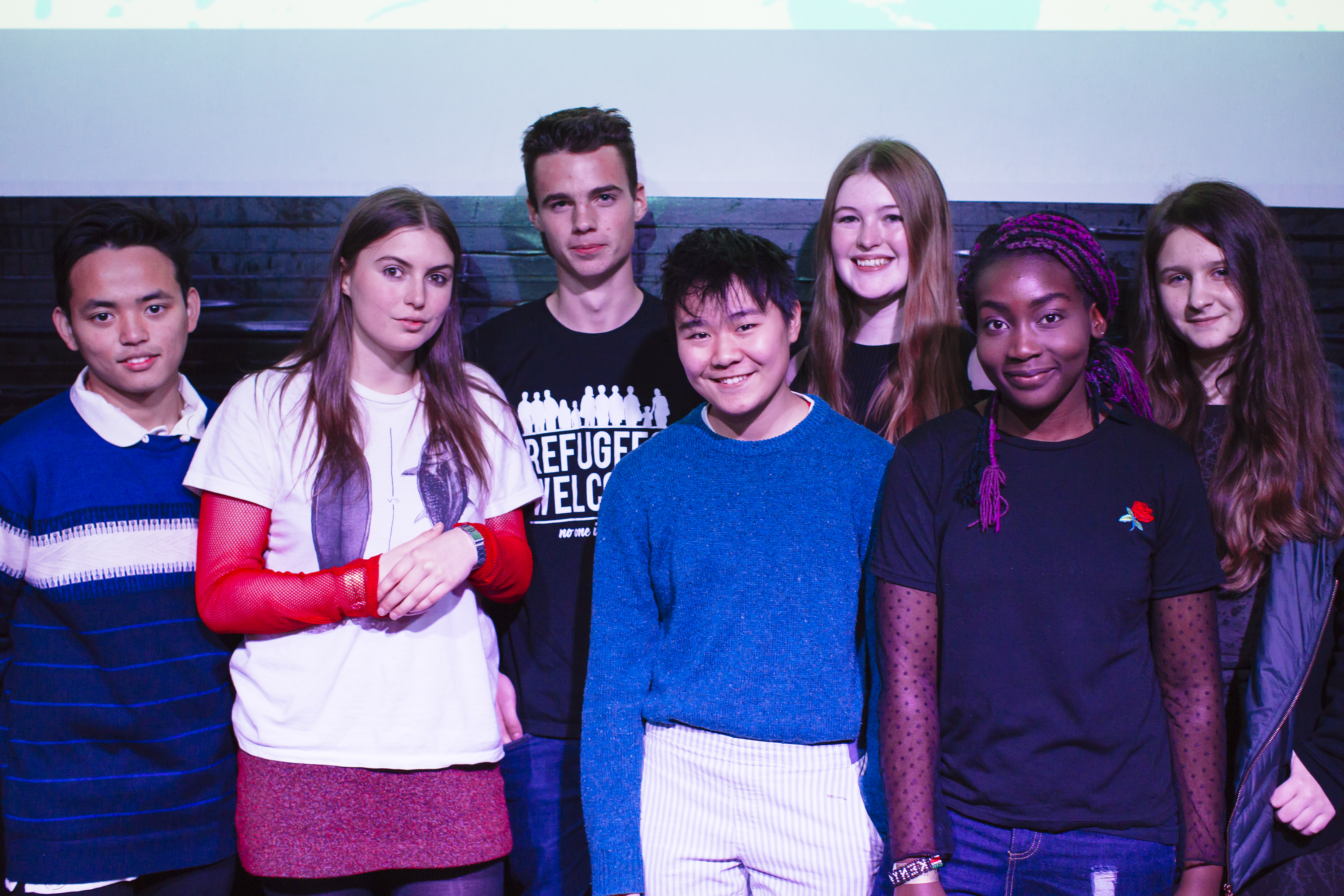 Image of SLAMbassadors 2017 winners: from left to right, Mukahang Limbu, Emmeline Armitage, Eben Roddis, Honey Birch, Chelsea Stockham, Arinola Adegbite, and Charlotte Sonnex. Photo by Cesare de Giglio for The Poetry Society.
