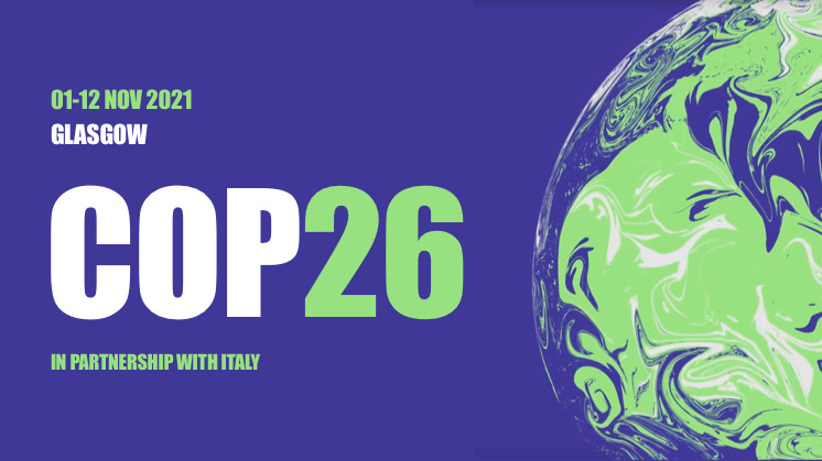 COP26 logo: white and green text on a blue background with a swirling green illustration of the Earth