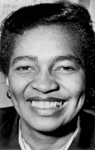 Black and white photo of Claudia Jones's face, smiling