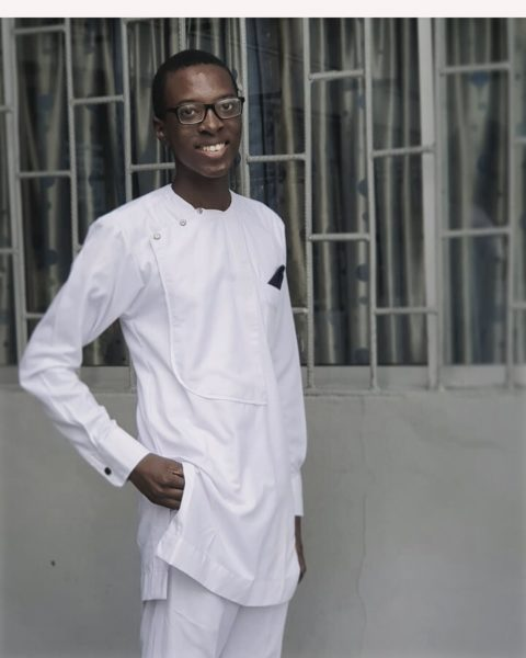 Photo of Ife Olatona, dressed all in white and smiling
