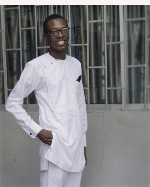 Photo of Ife Olatona, dressed all in white and smiling