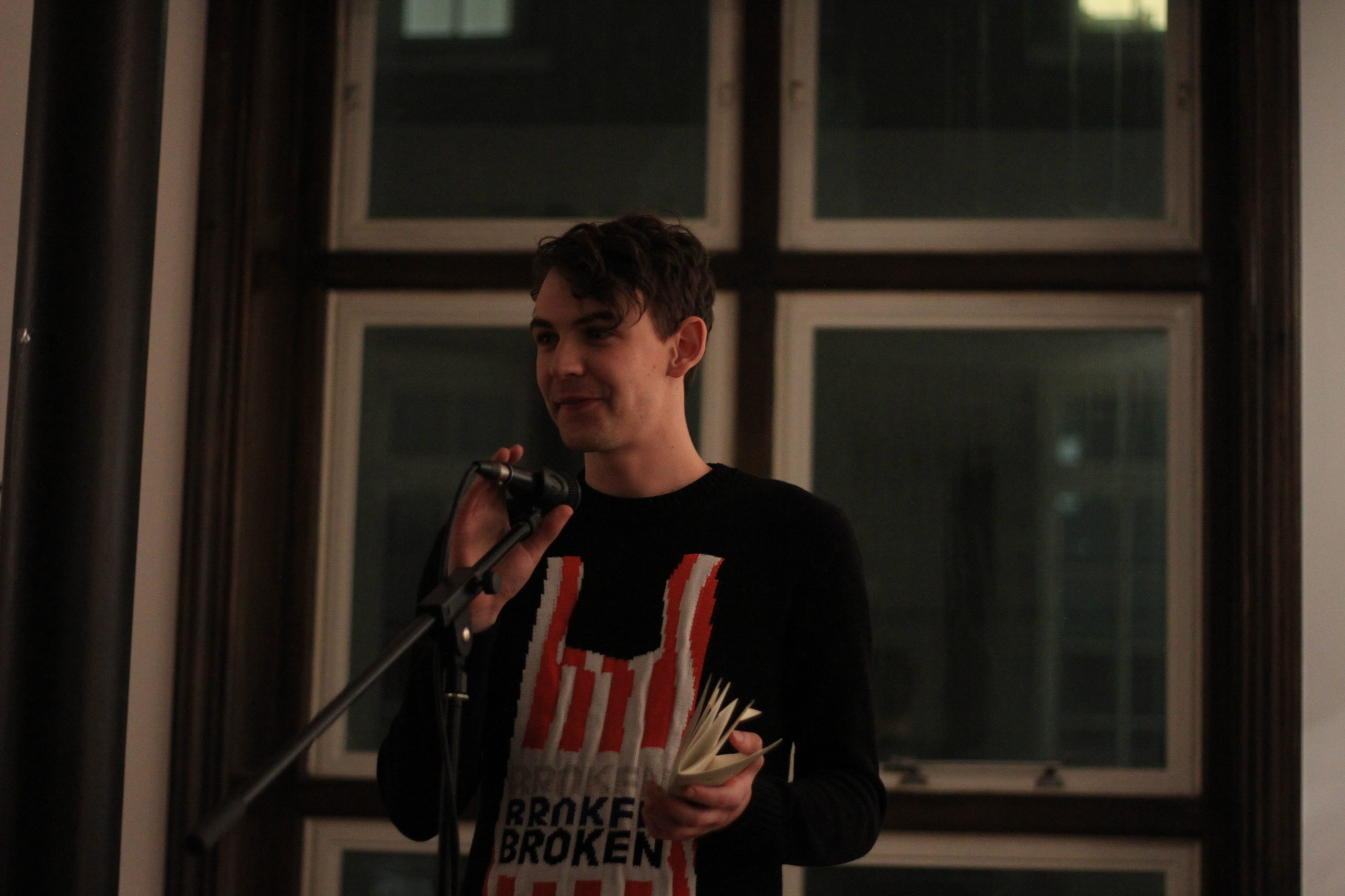 Photo of James Trevelyan reading in front of a microphone