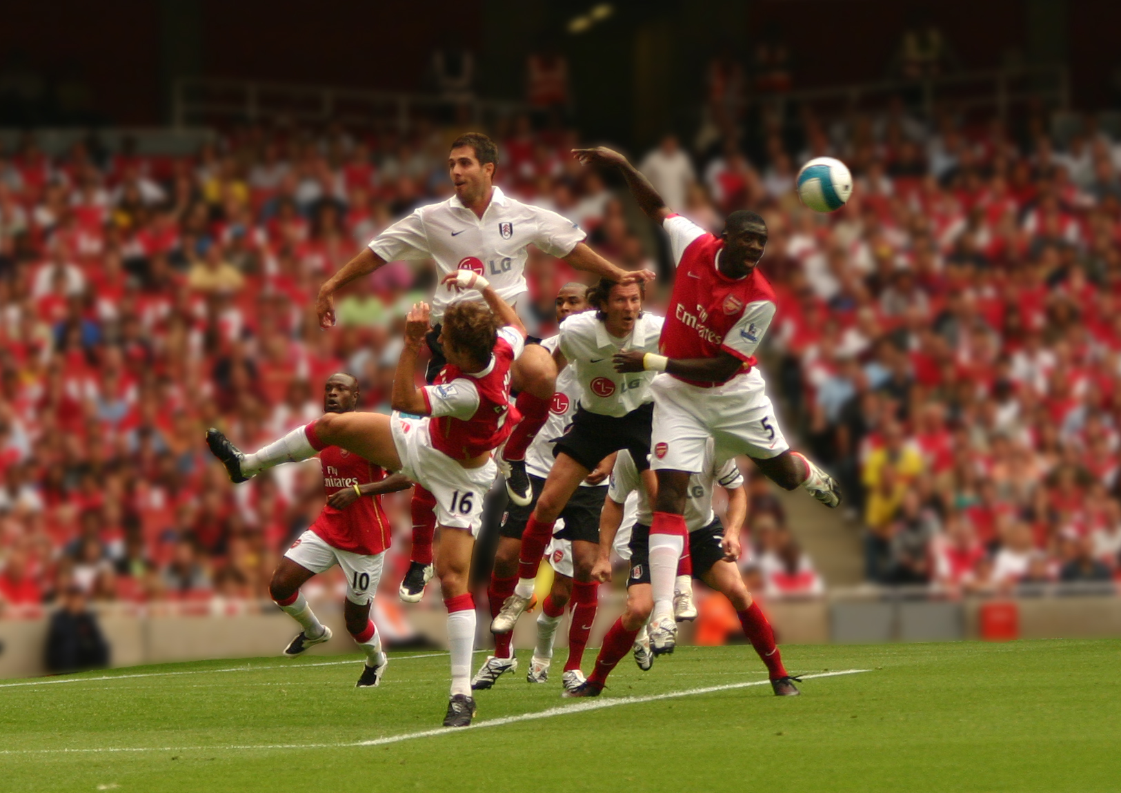 Photo of a crowd of football players leaping to header a ball, featuring Kolo Touré