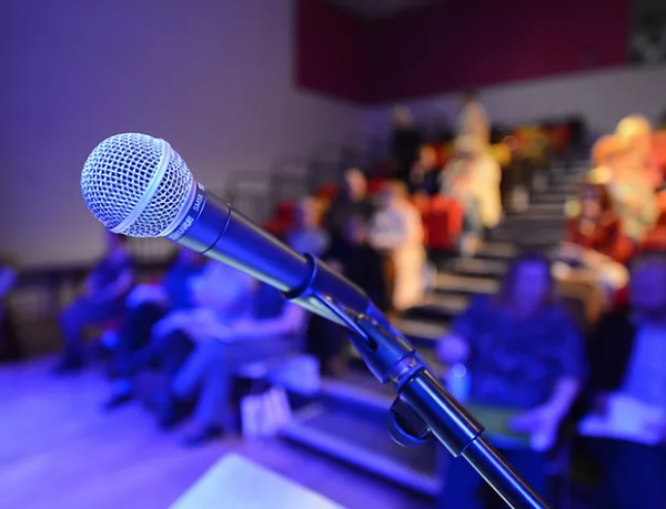 image of a microphone on stage