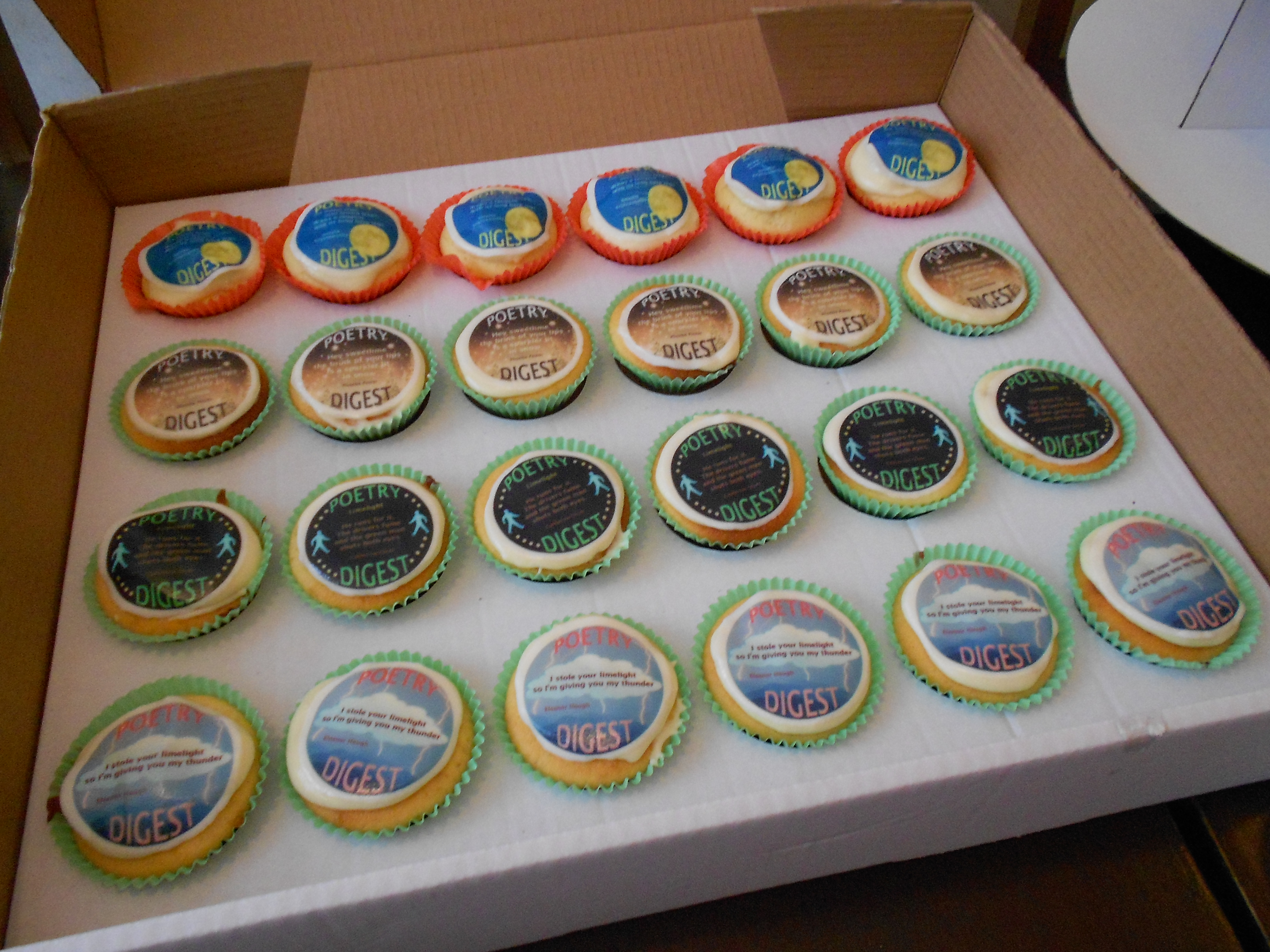 Photo of 20 cupcakes in a box, with 4 different styles of icing on top, each with a poem on