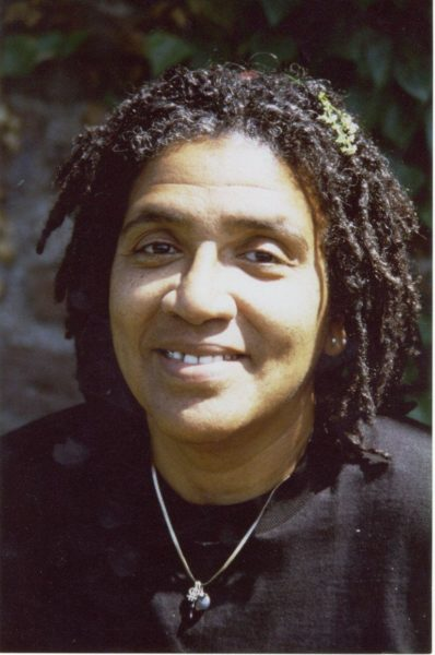 Audre Lorde smiles wearing black