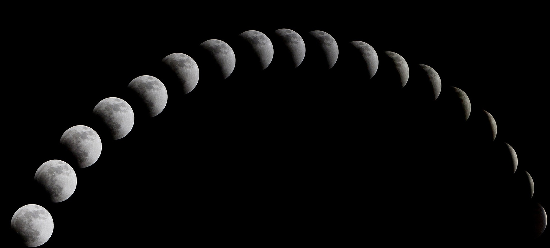 different photos of moons at different phases