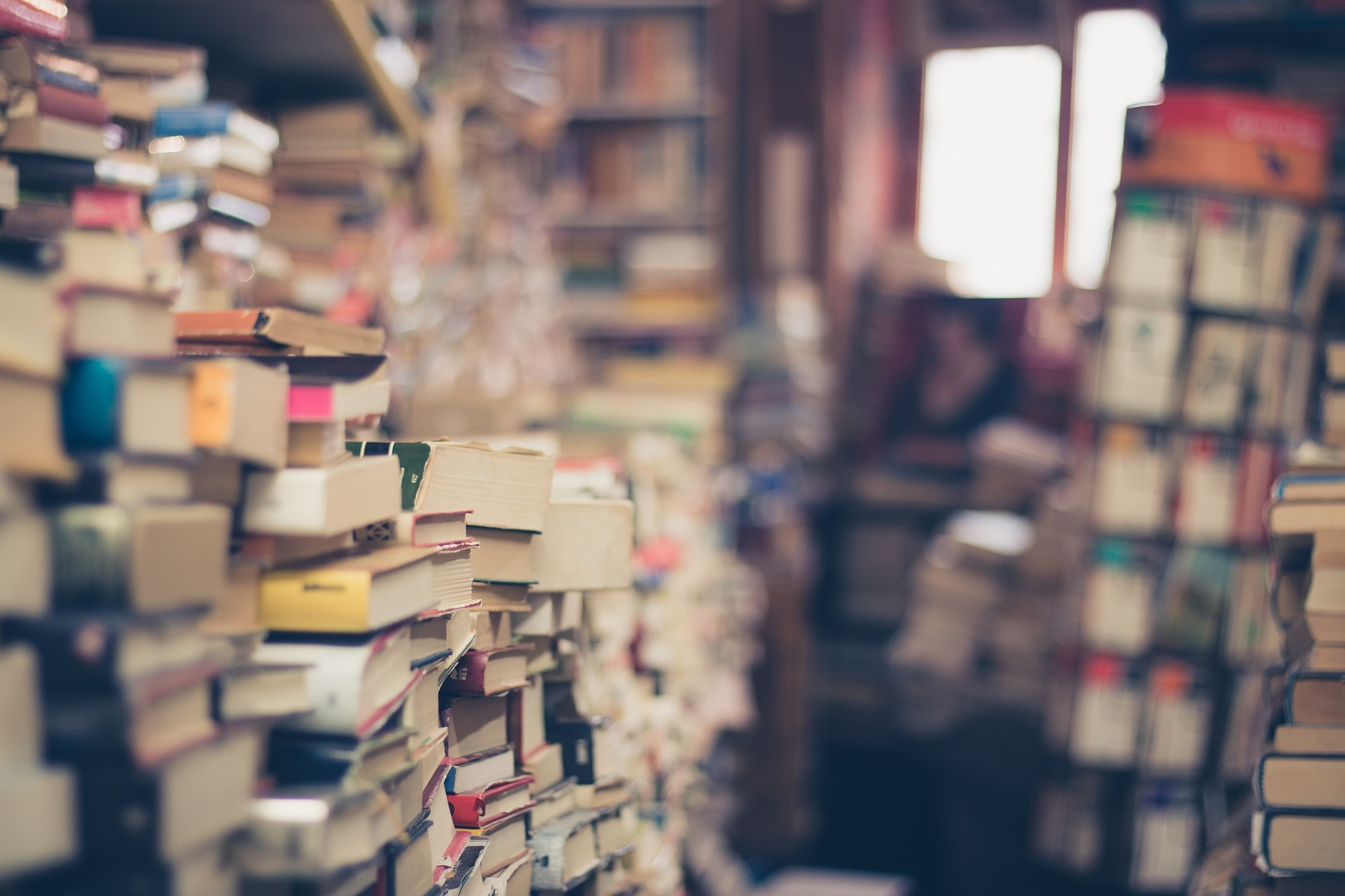 image of books stacked on one another into the distance