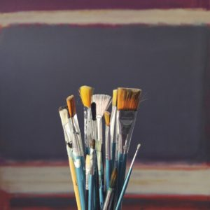 paint brushes gathered together on a blank background