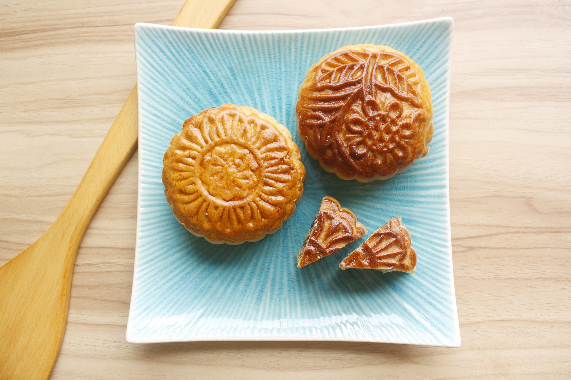photo of two round and decorated Chinese mooncakes