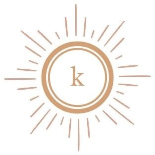 Kalopsia logo. . It is a gold K in a gold circle, surrounded by some gold lines. The background is white.
