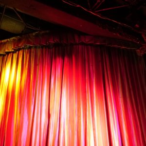 Photo of red curtains on stage