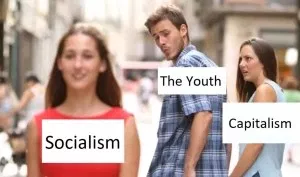 """distracted boyfriend"" meme as above, with the man labelled 'The Youth', the woman whose hand he's holding 'Capitalism' and the woman in the foreground 'Socialism'"