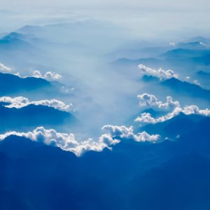 photo of blue mountains peeking through clouds