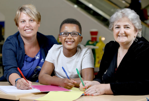 Picture: Lorne Campbell / Guzelian Kirkgate Shopping Centre's partnership with Reading Matters to launch its annual `Bradford Young War Poet' competition. Taurean Evans (11)is pictured with Catherine Riley (right) Kirkgate Centre manager, and Rachel Kelly, chief executive of Reading Matters.
