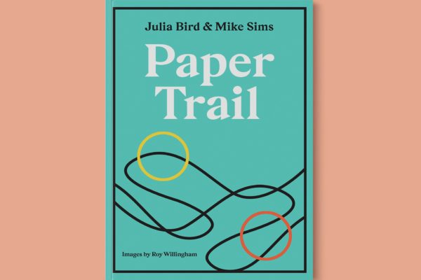 Book cover of Paper Trail by Julia Bird and Mike Sims: a turquoise/teal background with line drawings - a squiggly brown line joins a yellow circle with a red circle