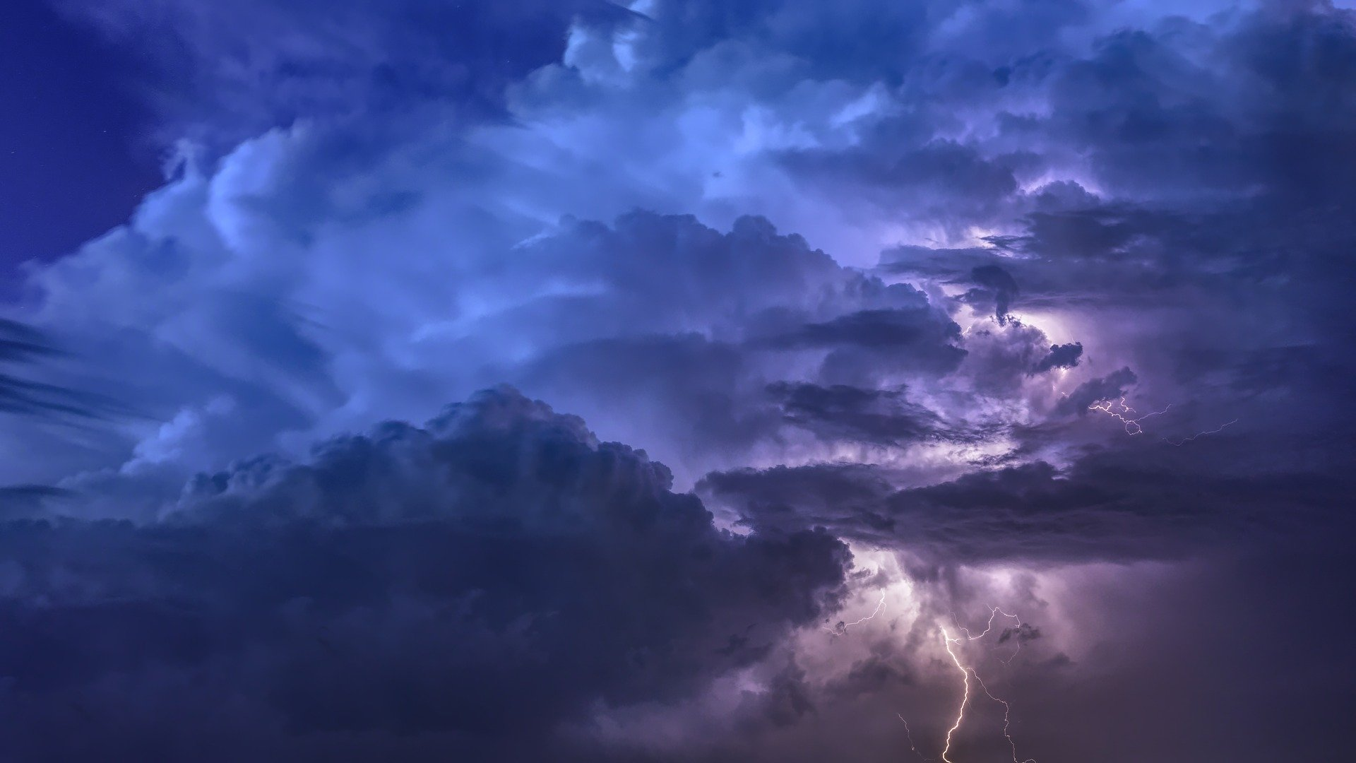 Photo of a thunderstorm at night - blue clouds