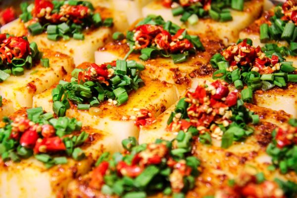 Photo of braised tofu with chopped spring onions and chilli on top