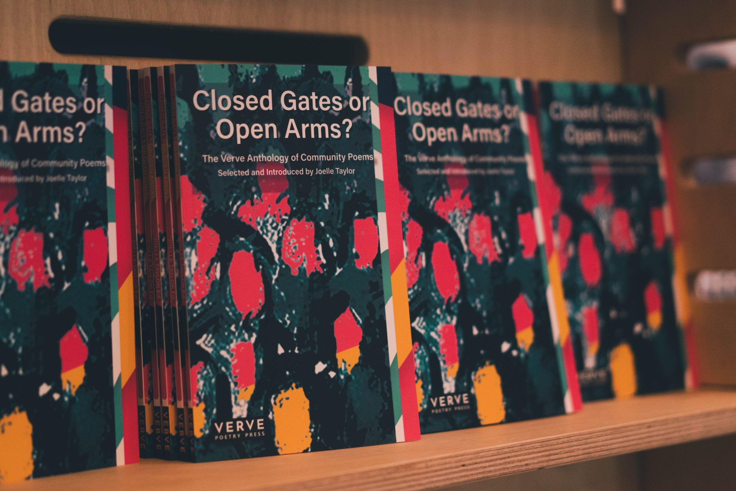 Photo of the book 'CLosed Gates or Open Arms?' an anthology edited by Joelle Taylor and printed by Verve Poetry PRess