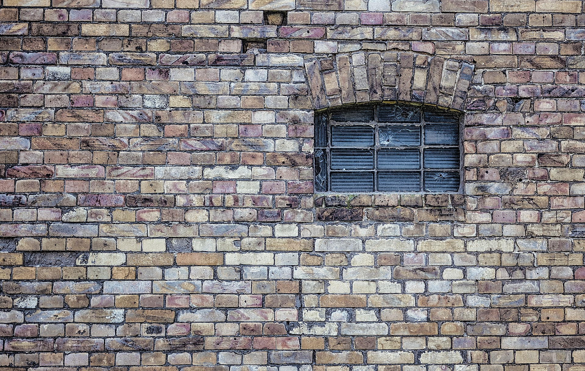 Brick wall with a barred window